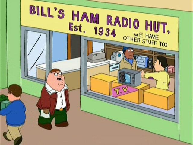 there Peter is watching TV though the window of a Bill's Ham Radio Hut.